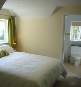 Double bed with en suite bathroom with bath and shower